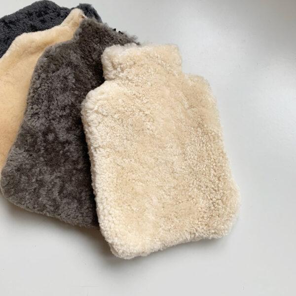 Shepherd sheepskin warm water case creme